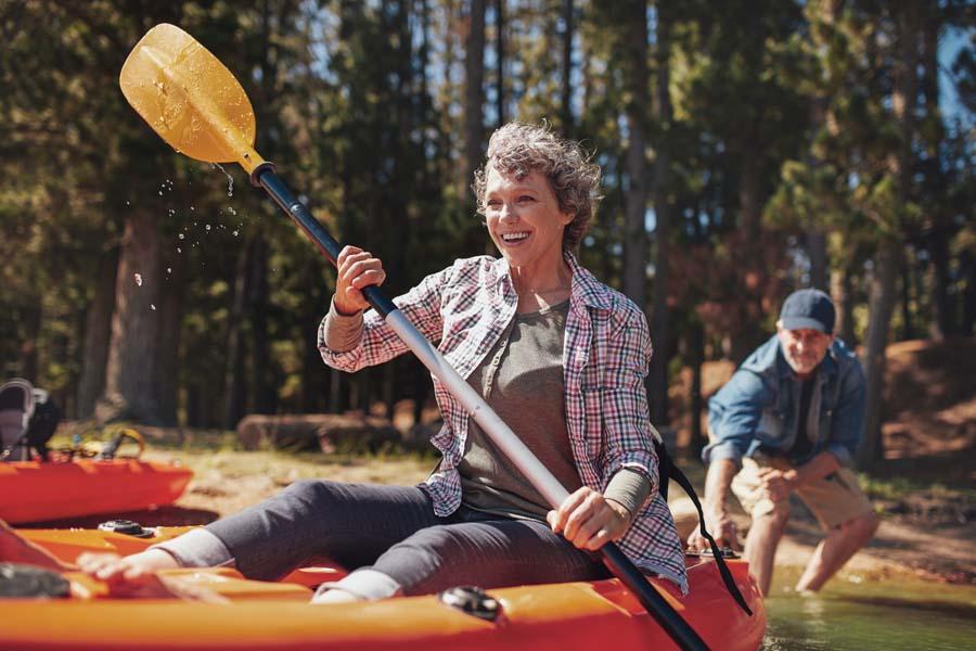 Blog - Older Couple Kayaking on the Lake During the Summertime
